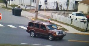 Dover Police released this image of the red Jeep Commander that homicide victim, Yusif Lamb, may have occupied prior to the shooting